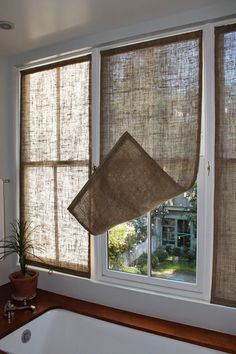Last week I made some new burlap window coverings for the master bathroom. I made three stationary panels from upholstery grade bur...