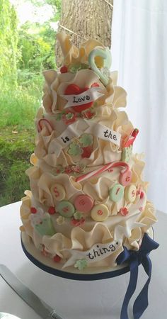 Love is the sweetest thing wedding cake