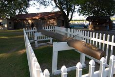 "Indian Village - Pipe - NYS Fair  In 1932 Franklin D. Roosevelt, then Governor of New York State, was made a blood brother & dedicated this large ceremonial pipe. Later while visiting the Fair as President in the fall of 1933, Roosevelt issued an ""Executive Order"". With this order a handful of earth from the Indian Village was given to Onondaga Chief Andrew Gibson, designated as custodian of the Six Nations, since the Indian Village is in Onondaga Nation Territory."