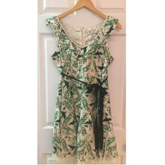 NWT Forever 21 Green Bird Print Dress Delightfully feminine dress from Forever 21. Bird and leaf print in green. Ruffled opening and lace details. Ribbon belt and zipper in back. New with tags. Makes me think of a garden party. 70% cotton/30% silk. With a polyester lining. Size Large. Forever 21 Dresses Midi