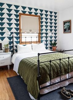 Geometric Patterns Perk Up a Mid-Century Home in Oregon | Design*Sponge | Diamond ticking quilt by Schoolhouse Electric
