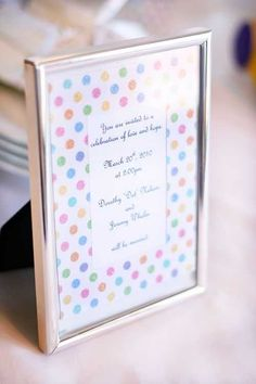 I love polka dots. Like. Love love polka dots. I even pretend I have polka dot underwear. Dont judge. But anyway, I was in love with this cake from its conception. This happy fun sparkly polka dot invitation paper was the perfect inspiration. I wrapped long skinny glass vases in the paper. And