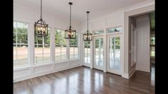 Love the wall of windows and the french doors