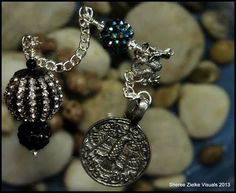 Dragon elements, Celtic influenced components, or a medieval theme make for very handsome personal pendulums.