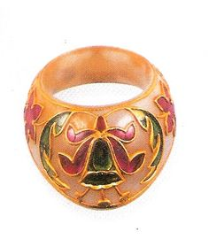 Archer'Archer's Thumb Ring of Mughal royalty. The Ring is made with Jade, Rubies and Emeralds