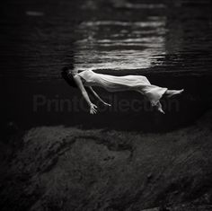 Weeki Wachee Spring, Florida. Photograph shows underwater view of a woman…