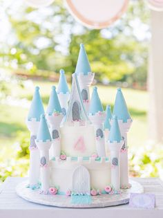 Amazing Princess Castle Cake from a Royal Princess Birthday Party featuring Cinderella, Belle, Snow White, and more!