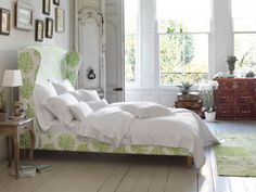 White bedroom with bold green bed | decorating with plants