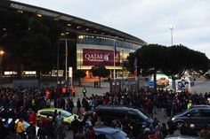 Fans wait for the teams to arrive prior to the La Liga match between FC Barcelona and Real Madrid CF at Camp Nou on March 22, 2015 in Barcelona, Catalonia.