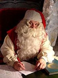 Santa Claus making a list and checking it twice.