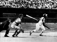 April 8, 1974: HANK AARON TOPS BABE RUTH'S CAREER HOME RUN RECORD - Hank Aaron of the Atlanta Braves hit his 715th career home run in a game against the Los Angeles Dodgers, breaking Babe Ruth's record.