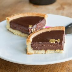 A classic #French #dessert - #chocolate tarts made from scratch with a rich dark chocolate filling and decorated with edible gold paper
