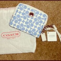 I just discovered this while shopping on Poshmark: NWT COACH Blue & White Wristlet Wallet & Dustbag!. Check it out!  Size: OS