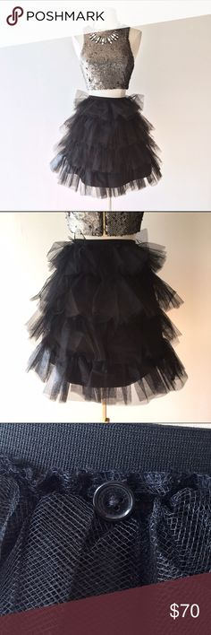 Marc by Marc Jacobs tiered black tulle tutu skirt Gorgeous layered tulle skirt, a perfect staple for any girly girl's wardrobe! Stiff black tulle with lots of volume, for a tutu effect. Size 2. Elastic waist. Great condition. I thrifted this, so I cannot guarantee it's authenticity. Therefore, I've priced it as if it were a lower level brand. It is a beautiful piece regardless of brand!! Marc by Marc Jacobs Skirts