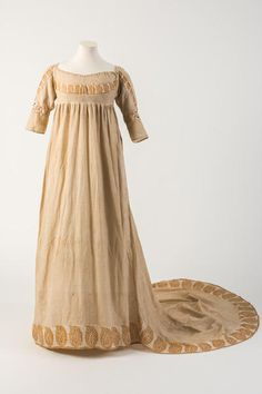 Orange/yellow printed cotton gown, with pine cone or patka motif, 1800  Bath Fashion Museum