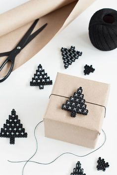 Gift wrapping decorations made of perler beads. Perler Beads, Fuse Beads, Hanging Christmas Tree, Christmas Gifts, Xmas Tree, Holiday Gifts, Christmas Paper, Rustic Christmas, Navidad Diy