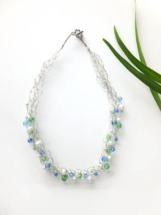 This spring necklace is the perfect accessory to add a simple elegance to any outfit! Wear it to dress up a casual outfit or to complete your formal look. Designed with the modern woman in mind, this beaded necklace is not only unique and stylish but also easy and comfortable to wear.
