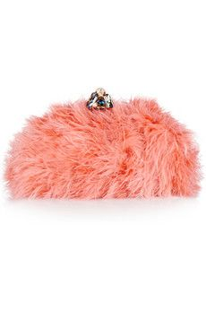 Dolce & Gabbana Jewel-clasp feather clutch $2345 Set with a multicolored crystal jewel clasp and finished with a silk-satin frame, this papaya feather clutch epitomizes the mega-watt glamour we've come to expect from iconic Italian brand Dolce & Gabbana. Carry it to add a fabulous note of color to your cocktail-party outfit.