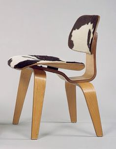 "Eames plywood side chair upholstered in ""Pony Skin"". Really cow hide I'm sure. I love it!"