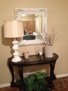 foyer table with lamp and mirror by sheena