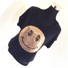 Stranded Gold Sequin Smiley Black Top NWOT A fun top! Measurements on request.   Please ask ALL questions before you buy as all sales are final. I try to describe the items I sell as accurately as I can but if I missed something, please let me know FIRST so we can resolve it before you leave < 5rating.   TRADES/OFFLINE TRANSACTIONS LOWBALLING (Please consider the 20% PM fee) ✅Offers only through the OFFER BUTTON  100% Authentic items   &  Free home Stranded Tops