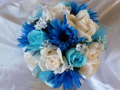A personal favorite from my Etsy shop https://www.etsy.com/listing/226290465/blue-and-ivory-rose-and-gerbera-daisy