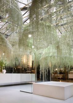 french designer patrick nadeau has created an installation for italian brand boffi, consisting of hanging domes covered in living plants
