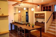 love how modern kitchen is blended into the wooden things