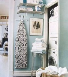Like the idea of narrow shelves and ironing board on a wall in the laundry room space.