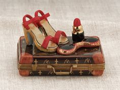 Limoges elegant suitcase with red sandals and lipstick box