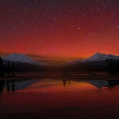 """photo courtesy of: @skylerhughes_photo ⠀An amazing photo of the aurora borealis (northern lights) over the South Sister on the left and Broken Top on the right at Sparks Lake, 27 miles west of Bend. Named for a 19th-century rancher, """"Lige"""" Sparks, the water body is a remnant of a bigger lake that has partly filled with sediment and vegetation. Many of the region's mountain peaks, such as Mount Bachelor, Three Sisters, and Broken Top, are visible from the lake. The Aurora Borealis is most…"""