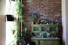 I feel comforted by the images from inside the Brooklyn apartment home of Pamela Love and Jordan Sullivan.  This kitchen nook bustling with plants and upcycled furniture makes me feel particularly warm on the inside.