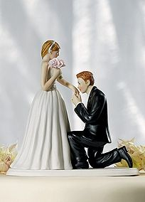 On bended knee, this groom isn't afraid to express how much he loves his beautiful bride. Stunning and sweet, this cake topper is ideal for the romantics. Measures: 5 1/4 inches x 2 7/8 inches x 5 1/8 inches. Weight: .9 lbs