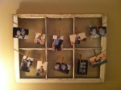 Old window turned picture hanger with twine hot glued on and clothes pins! Also handy for Christmas cards!
