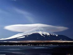 """Lenitcular cloud over Mount Fuji, Japan   I These clouds, often referred to as """"UFO clouds"""" (for obvious reasons), are officially called lenitcular, or lens-shaped, clouds. They are super bizarre, and people all over the internet seem to really love them, and it's easy to see why."""