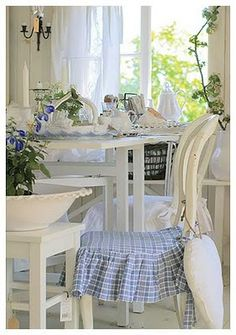 crisp white and blue,  love the chair cushions