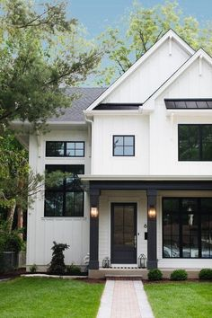 Door and porch pillars are painted in Sherwin Williams Iron Ore. 2019 Door and porch pillars are painted in Sherwin Williams Iron Ore. The post Door and porch pillars are painted in Sherwin Williams Iron Ore. 2019 appeared first on House ideas. White Farmhouse Exterior, White Exterior Houses, House Paint Exterior, Exterior Siding, Exterior House Colors, Modern Exterior, White Siding House, Black Trim Exterior House, Farmhouse Front
