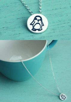 "This miniature penguin necklace is handcrafted out of eco-friendly reclaimed silver designed to make you happy every time you see it! Threaded onto an 18"" fine silver chain this pendant measures appro"