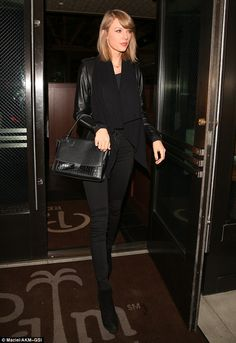 Taylor Swift slips her slender legs into skinny jeans as she switches her preppy style for vampy all-black on dinner date | Daily Mail Online