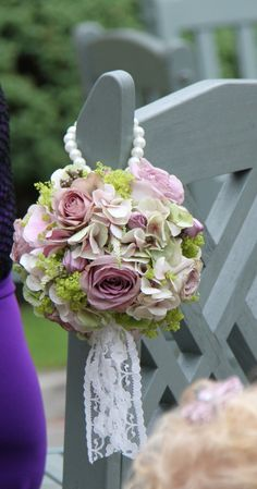 Pomander @Rachel Ayres , we could do it like this on the outside of chairs down the aisle???