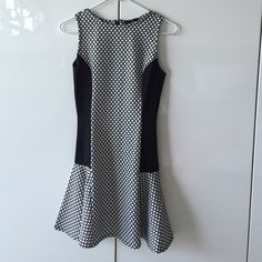 Pretty black and white dress! Figure-flattering with black panels down the sides to make you look slimmer. UK size 8 is size 4. Purchased from Asos. ASOS Dresses