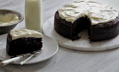 NYT Cooking: For me, a chocolate cake is the basic unit of celebration. The chocolate Guinness cake here is simple but deeply pleasurable, and has earned its place as a stand-alone treat. Köstliche Desserts, Delicious Desserts, Yummy Food, Chocolate Guinness Cake, Chocolate Cake, Chocolate Recipes, Cooking Chocolate, Food Cakes, Cupcake Cakes