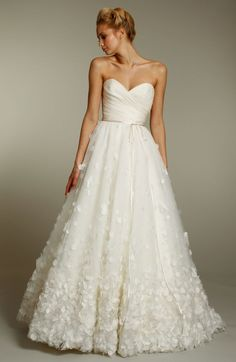 Jim Helm Ivory a-line wedding dress with sweetheart neckline and embellished skirt