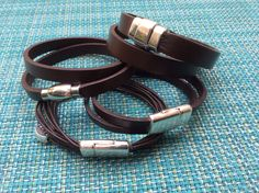 The Double, Mini Double, Love, Hotcake bracelets.  Chocolate leather in black or brown wrap around your wrist.  Stack all 4 for $120 instead of $125 !    Attached with #metalclasp. #juicyjewelsbyelena #juicyjewelsbyel #  leather #leatherbracelet #leathercuff #boho #tattoo #mens #womens #trendy #accessories #braceletstack #stackbracelets  www.etsy.com/shop/juicyjewelsbyelena jewelsjuicy33@gmail.com   $120.00