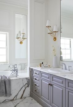Classic, modern and Hamptons style bathroom with marble, grey vanity and gold accents. Small Laundry Rooms, Laundry In Bathroom, Hampton Style Bathrooms, Pool Chairs, Gray Vanity, Inviting Home, Visual Comfort, Stone Flooring