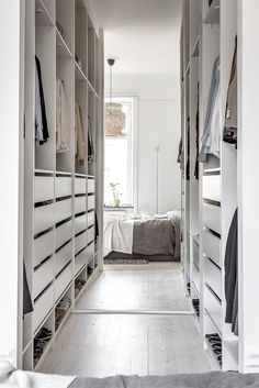 Clothes open storage with IKEA PAX - love how the mirror enlarges this room. #ClosetStorageDesign