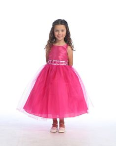 Fuchsia Flower Girl Dress with Rhinestone And Tulle Skirt: This gorgeous fuchsia rhinestone flower girl dress features a taffeta bodice and tulle skirt with additional netting underneath for a full volume ballerina skirt look. The waistline is embellished with elegant rhinestone jewels, delicate beading, and sequin. Your little flower girl will be the belle of the day in this exquisite fuchsia dress.