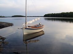 """Burton sent this great shot of his Houdini """"Jackrabbit"""", which he built a few years back and cruised on Lake Superior, the Ottawa River, and other Canadian inland waterways. Thanks Burton Ottawa River, Page Three, Jack Rabbit, Dinghy, Lake Superior, Wooden Boats, Great Shots, Great Lakes, Sailboat"""