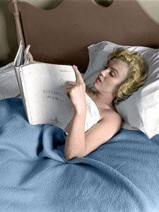 Marilyn Monroe- in bed reading scripts