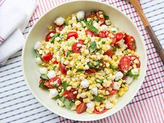 Fresh Corn and Tomato Salad : Looking for a fresh side dish this summer? Look no further with this fresh corn and tomato salad, tossed with creamy mozzarellapearls, basil and a tangy dressing. Brought to you from our Food Network Kitchen.
